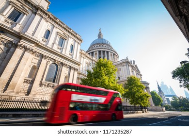 St Pauls Cathedral with sun flare and famous red bus