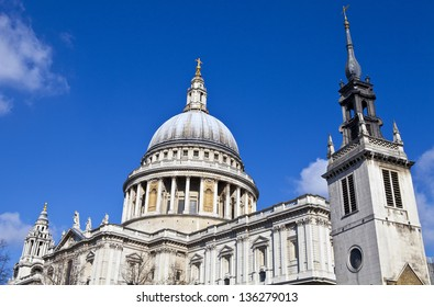St. Paul's Cathedral and the Tower of the former St. Augustine Church (now the St. Paul's Cathedral Choir School) in London.