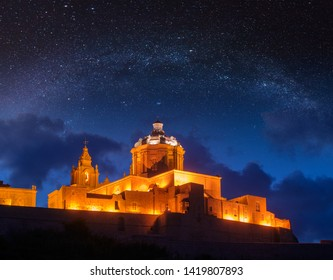 St. Paul's Cathedral under starry sky. Mdina, Malta. Photo Manipulation