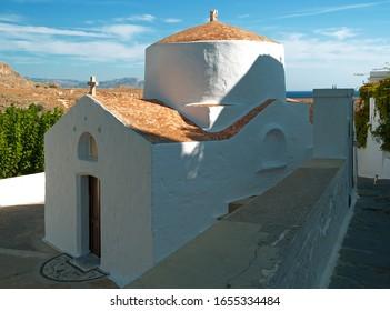 St Paul's Chapel - Iconic white chapel in Lindos, Rhodes, Greece near St Paul's Bay.