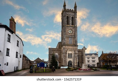 St Pauls Church, Honiton with war memorial cross in Honiton, Devon, UK on 14 November 2019