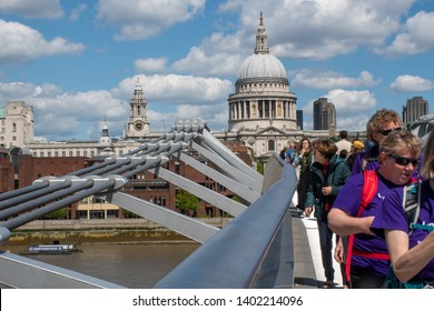 St Pauls  London  United Kingdom  -12 May 2019: Tourists Crossing Millenium Bridge with St Pauls Cathedral in Background