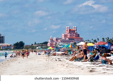 St. Pete Beach, Florida, April 2018:  People enjoy the sand and waves on St. Pete Beach on a sunny April day with the Don CeSar Hotel in the background.