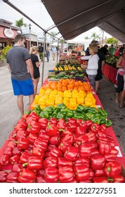St. Pete Beach, Florida, November 4, 2018: Shoppers browse the vegetables and peppers at a weekend farmers market in St. Pete Beach, Florida.