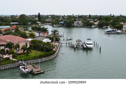 ST. PETE BEACH, FLORIDA / USA - MARCH 31, 2018: Arial view of expensive waterfront homes with docks and boats.