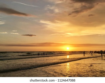 St Pete beach, Florida, USA - July 26, 2016: A beautiful sunset over the Gulf of Mexico is viewed from the beach at Treasure Island, Florida.