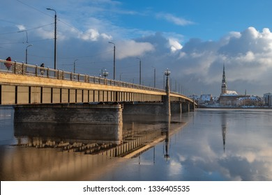 st Peter Church in the old Riga. Stone bridge across river Daugava