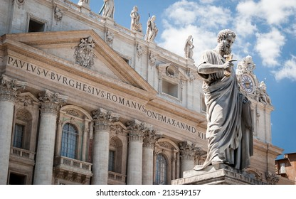 St. Peter, Vatican City. Low angle view of the statue of St. Peter in St. Peter's Square, Vatican City, with the front of the famous Basilica in the background.