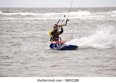 ST. PETER-ORDING, GERMANY - JULY 22: Professional  kite-surfer Caropin Arthaud, France,  demonstrates his ability on the Palmolive Kitesurf Worldcup 2010, July 22, 2010 in St. Peter-Ording, Germany