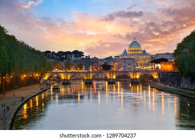 St. Peter's Basilica and Bridge Sant Angelo at sunset in Rome, Italy
