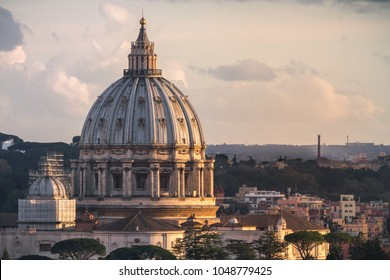 St. Peter's Basilica Dome from above the city at sunset after a storm