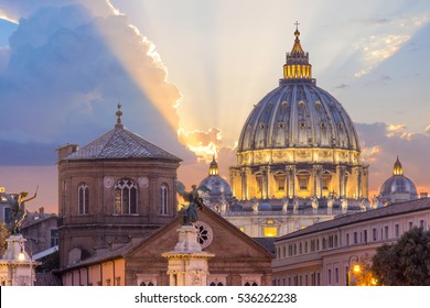 St peter's basilica in Rome,Vatican, the dome at sunset, with dramatic clouds