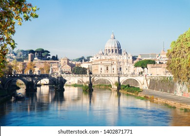 St. Peter's cathedral over bridge and Tiber river in Rome at summer, Italy