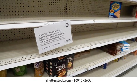 St. Peters, MO, USA April 4th 2020: Empty shelves inside of Target due to the COVID-19 pandemic. Sign restricting bulk purchase of food.