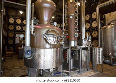 St Peter's Parish, Barbados - April 6 , 2017:Still no 85. A modern crafted still sits at ease in an old room full of history at the St Nicolas Abbey rum factory.