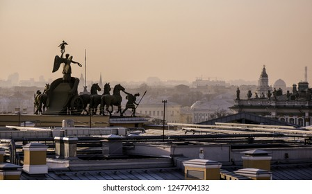 St. Petersbourg, Russia - Mar 18 2015: Over-roof view to the sculpture of the Genegal headquarters of Defense with Winter Palace and Kunstkamera in the background