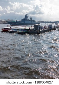 St. Petersburg - August 12, 2018: warships on the parade in honor of the Navy Day on the River Neva and people go on an excursion August 12, 2018, St. Petersburg, Russia
