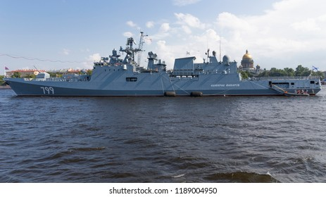St. Petersburg - August 12, 2018: Frigate Admiral Makarov at a parade in honor of the Navy against the backdrop of St. Isaac's Cathedral August 12, 2018, St. Petersburg, Russia