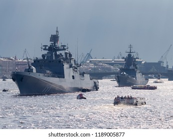 St. Petersburg - August 12, 2018: The military frigate of the Black Sea Fleet - Admiral Makarov and other ships in the parade in honor of the Navy on the River Neva August 12, 2018, St. Petersburg, Ru