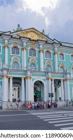 St. Petersburg - August 12, 2018: Beautiful museum building with columns - entrance to the State Hermitage and many people want to cross the road August 12, 2018, St. Petersburg, Russia