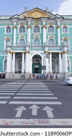 St. Petersburg - August 12, 2018: Beautiful museum building with columns - entrance to the State Hermitage and many people want to cross the road and arrows August 12, 2018, St. Petersburg, Russia