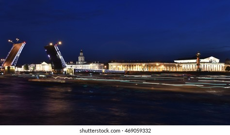 St. Petersburg By Night. Panorama of night city. View on the Neva river and the open bridge.
