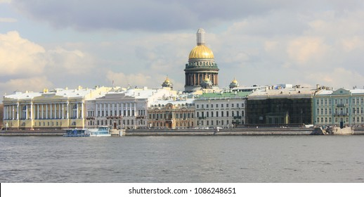 St. Petersburg City Panorama with Saint Isaac's Cathedral and Historical Old Buildings Architecture in Russia. Cityscape View with Classic Houses on Neva River Embankment on Summer Day Scene.