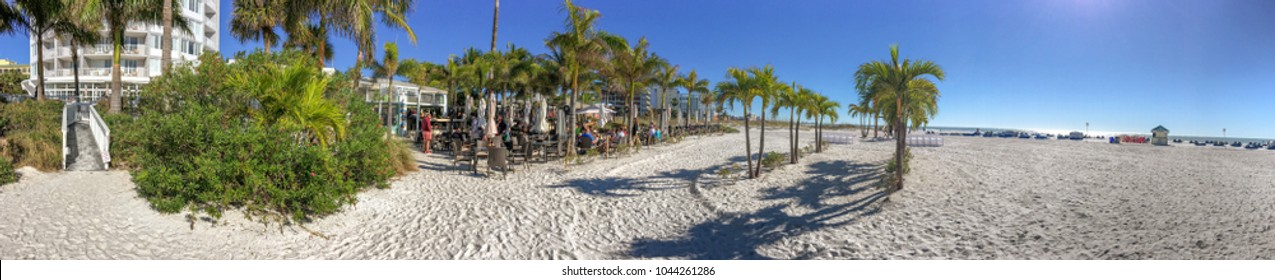 ST PETERSBURG, FL - FEBRUARY 5, 2016: Tourists and locals enjoy St Pete Beach. It is a famous attraction in Florida.