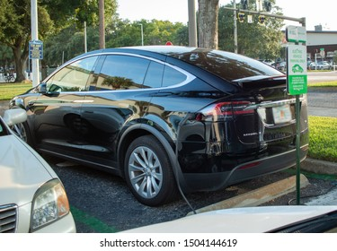 St Petersburg, Fl / US - 09 01 2019: A new Tesla Model X charging in downtown St Petersburg outside Tampa Bay Rays Tropicana field parking lot