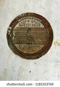 St. Petersburg, FLA - September 16 2018 - The storm drain manhole cover in downtown Saint Petersburg, Florida.