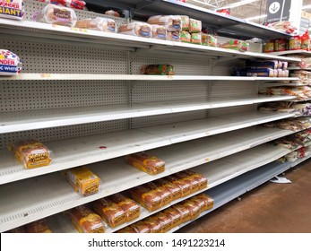 St. Petersburg, Florida, USA - 8/29/2019: Tampa Bay residents empty Walmart grocery store shelves as they stock food and prepare for Hurricane Dorian.