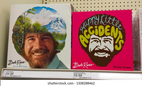 St. Petersburg, Florida / USA - August 2019: The Bob Ross Art of Chill board game next to the Bob Ross Happy Little Accidents Party Game on a shelf in Target.