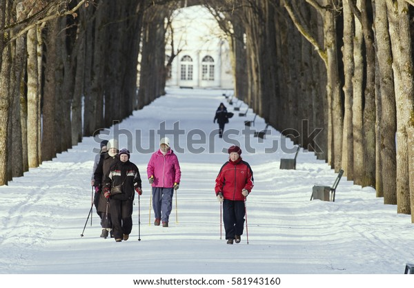 St. Petersburg (Pavlovsk Park),Russia - 15 February 2017: Elderly women are engaged in the Nordic walking in the winter park.
