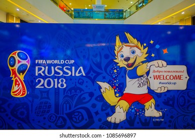 ST. PETERSBURG, RUSSIA, 02 MAY 2018: The official mascot of the 2018 FIFA World Cup wolf Zabivaka on the theatrical square Park of football holding a welcome sign in the picture