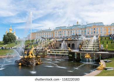 ST PETERSBURG, RUSSIA - 03 JUNE, 2018: Horizontal picture of beautiful cascade golden fountain at Peterhof, located in St Petersburg, Russia