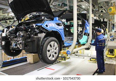 """St. Petersburg / Russia,  - 04.02, 2015. Automobile plant """"Hyundai Motor Manufacturing Rus"""" . Cars Production. Assembly of cars on the conveyor.  Installation of wheels."""