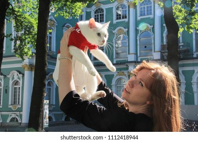St. Petersburg / Russia - 05.28.18, . Woman in Courtyard of Hermitage museum holds Achilles the cat,  from Hermitage Museum, which predict results of the World Cup 2018 football games.