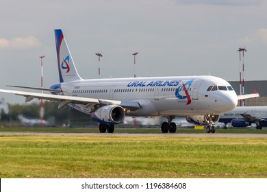 """St Petersburg, Russia - 08/16/2018: Short- to medium-range, narrow-body, commercial passenger twin-engine jet airliner Airbus A321 """"Ural Airlines"""" VQ-BGY in Pulkovo Airport."""