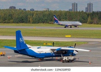 St. Petersburg, Russia - 08/16/2018: A turbojet airliner Aeroflot Airlines takes off at Pulkovo Airport, St. Petersburg (against the background of the An-26 Antonov EW-328TG). Official summer spotting