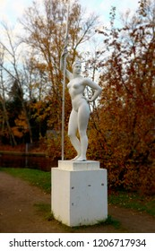 """St. Petersburg, Russia, 10.17.2018,  sculpture """"Girl with a paddle"""" in the autumn park, оn the nameless island of the river Krestovka, Socialist realism"""