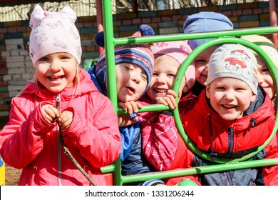 St. Petersburg, Russia - 11 April, 2018. Joyful smiles of children. Children on the street playground in kindergarten.