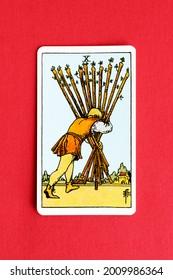 St. Petersburg, Russia, 12 July 2021: Illustrative editorial. Tarot card. Minor Arcana Ten of Wands.
