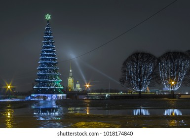St. Petersburg, Russia, 12.28.2017 New Year's tree in the Exchange Square on the Spit of Vasilievsky Island and a view of the Peter and Paul Fortress