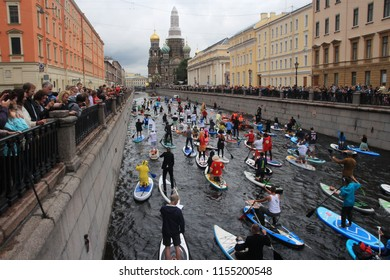 St. Petersburg / Russia - 21.08.2018-  Participants of Fontanka-SUP festival, biggest in Eastern Europe, moving by river in the city downtown, approaching to church or spilled blood