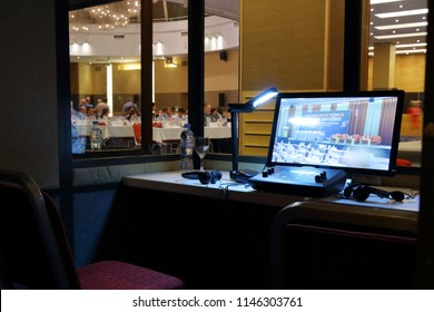 St. Petersburg, Russia - 25 JULY 2018 - hotel Baltic - Remote control, monitor, and headset of the interpreter in the cabin of simultaneous translation