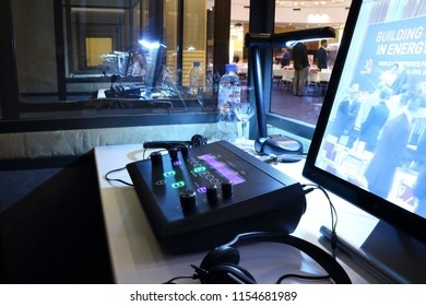 St. Petersburg, Russia - 25 JULY 2018 - hotel Baltic - Remote and headset of the interpreter in the cabin of simultaneous translation