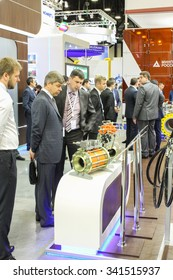 St. Petersburg, Russia - 7 October, 2015. Expo forum. International Gas Forum. Two men inspect the unit on the stand.