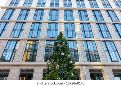 St Petersburg, Russia - 9 January 2021, Christmas tree on the background of a modern office building