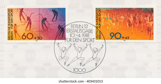 ST. PETERSBURG, RUSSIA - APR 10, 2016: A first day of issue postmark printed in Berlin, Germany, shows gymnasts and a mass sprint, circa 1981