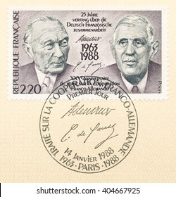ST. PETERSBURG, RUSSIA - APR 12, 2016: A postmark printed in France, dedicated to 25th anniv. Franco-German Cooperation Treaty, shows Konrad Adenauer and Charles de Gaulle and signatures, circa 1988